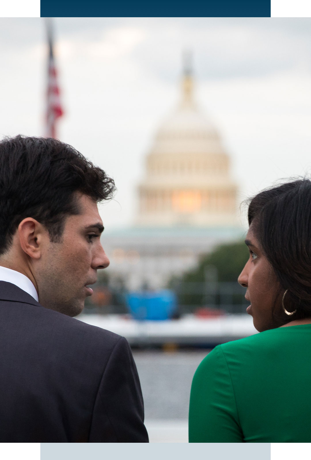 Man and woman talking in front of the capitol