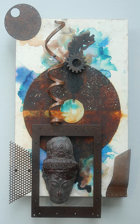 rust print with large metal (center) and small metal circle (left) on watercolor paper with blue and other colors and metal curl