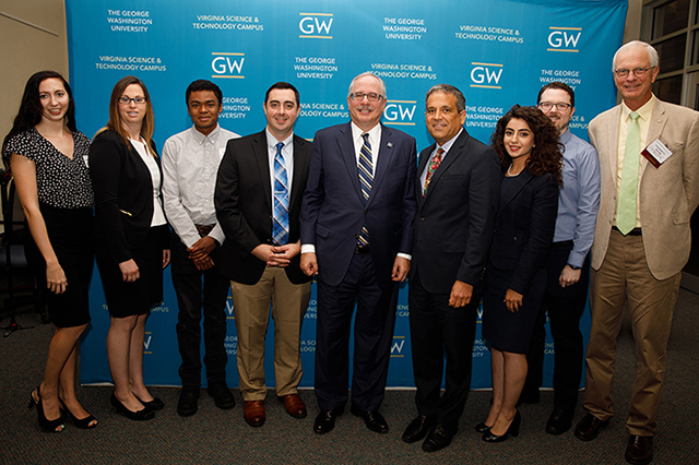 GW cyber students with administrators