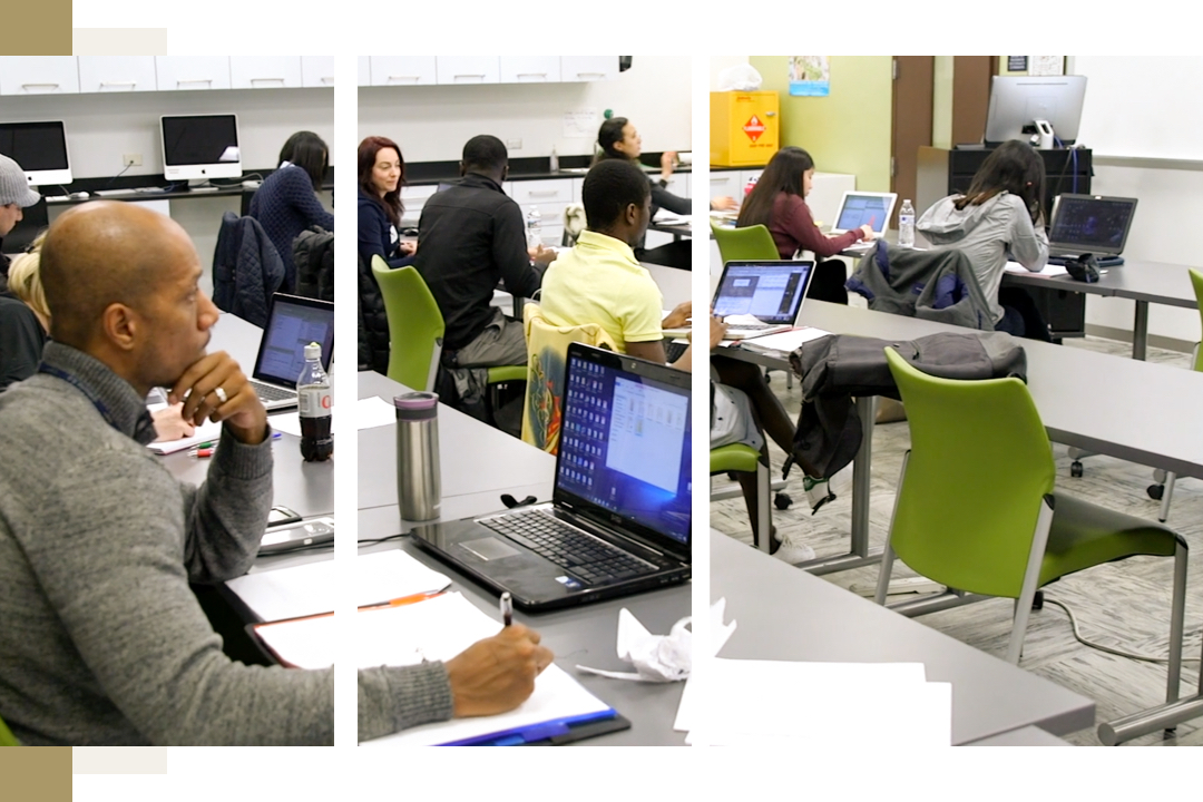 Students attend class in a computer lab classroom