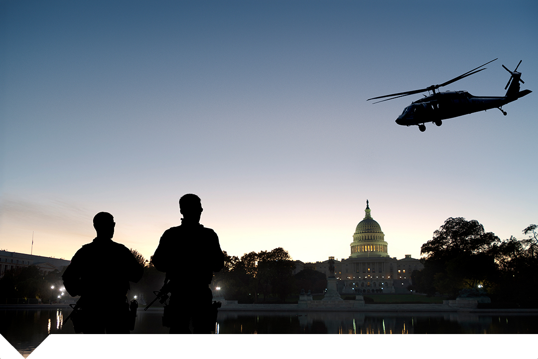 Security personnel near White House with helicopter