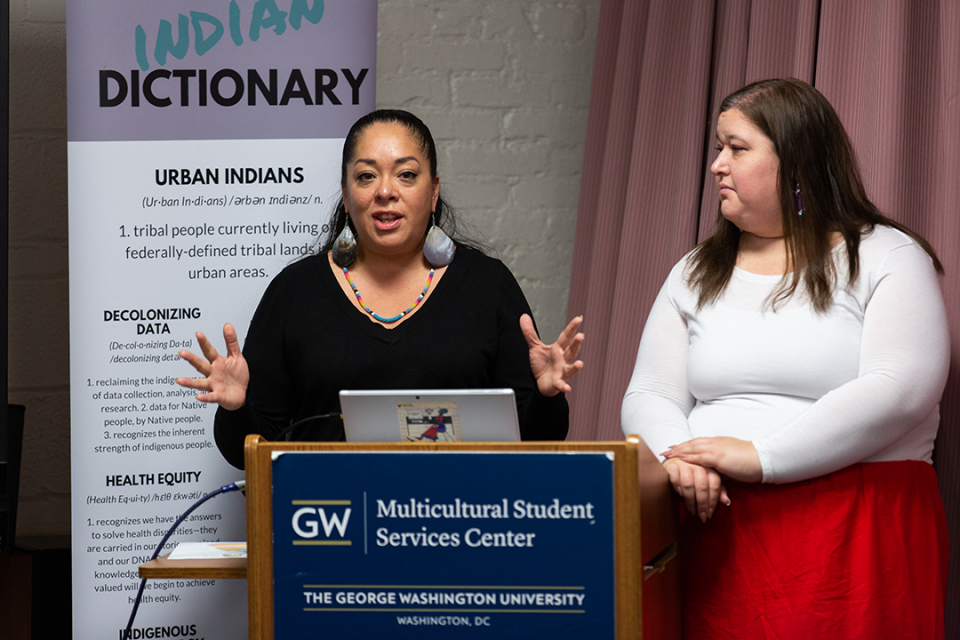 two women presenting report from the Urban Indian Health Institute at GW