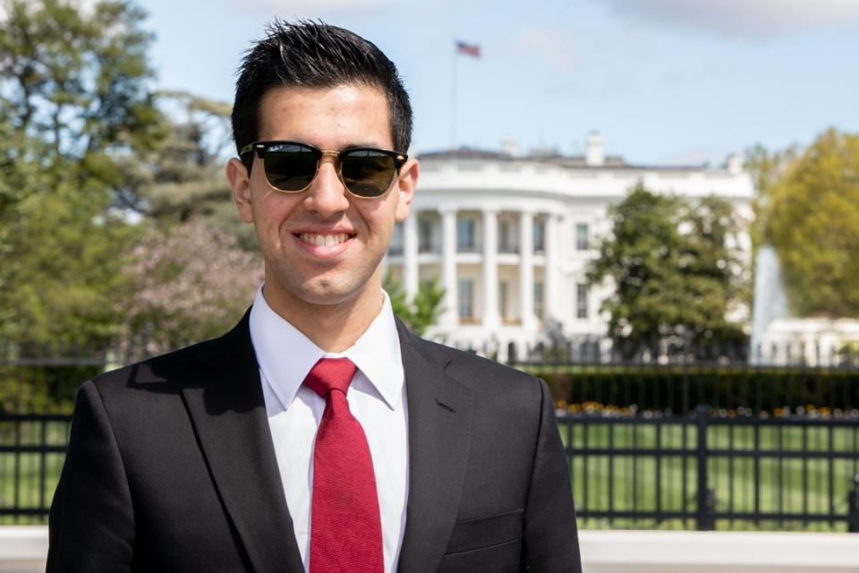 Adam Brown, GSPM '19, pictured in front of the White House
