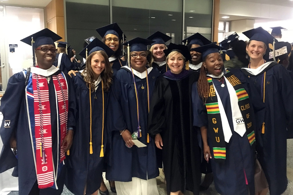 Paralegal student group in cap and gown attire