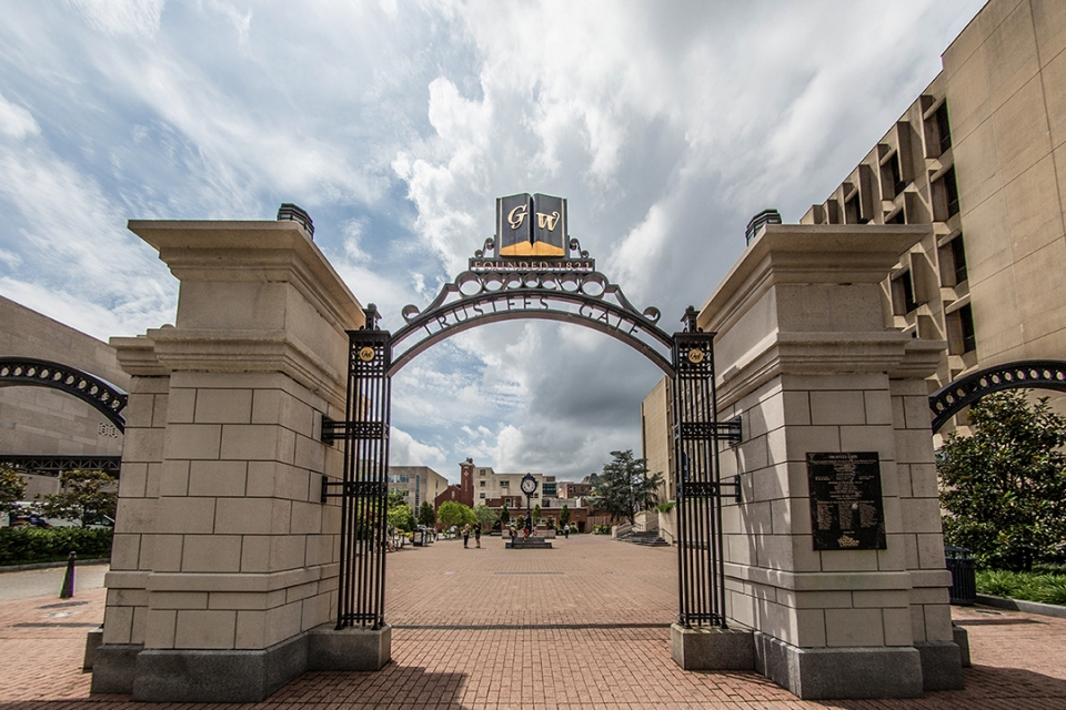 Trustees gate at GW with words GW above the arch