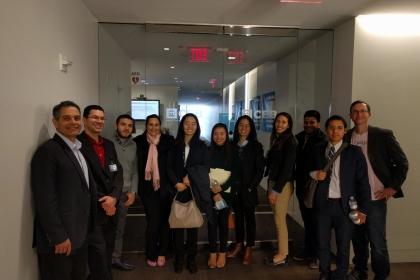 A dozen GW students during the site visit to the Corporate Executive Board posing in front of the building