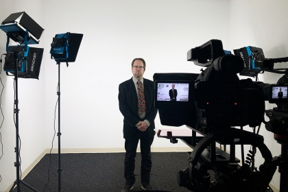 John Warren, publishing program director, filming in new studio