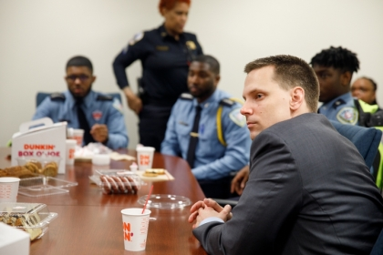Luke Lorenz GSPM with police officers at event he organized