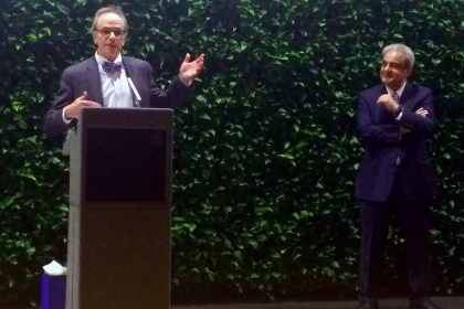 GSEHD Dean Michael Feuer speaks at the reception April 3 in honor of former dean Ali Eskandarian (right).
